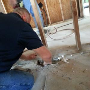 Gary cutting concrete